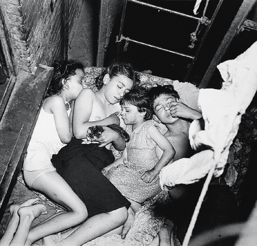 Weegee - Tenement sleeping during heat spell, Lower East  Side, New York, May 23, 1941